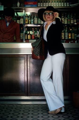 The Italian showgirl Raffaella Carrà, born Raffaella Maria Roberta Pelloni, poses standing at a bar counter. 1978.. (Photo by Rino Petrosino/Mondadori via Getty Images)