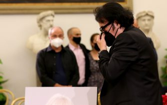 ROME, ITALY - JULY 08: Italian singer Renato Zero pays tribute to the Italian dancer, singer and actress Raffaella Carrà, who died at the age of 78, in the burial chamber of Rome's Capitol Hill on July 08, 2021 in Rome, Italy. (Photo by Franco Origlia/Getty Images)