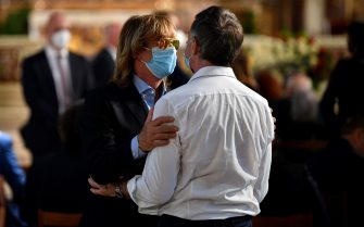 """Italian Dancer Enzo Paolo Turchi (L) is hugged prior the arrival of the coffin of Italian dancer, singer and actress Raffaella Carra to the Ara Coeli Church at Rome's Capitol Hill on July 9, 2021. - Raffaella Carra, a television and singing icon for generations of Italians, has died at 78, Italian media reported on July 5, 2021, citing her family. """"Raffaella has left us for a better world, where her humanity, her inimitable laugh and her extraordinary talent will shine for ever,"""" her ex-partner Sergio Iapino told the Ansa news agency. (Photo by Filippo MONTEFORTE / AFP) (Photo by FILIPPO MONTEFORTE/AFP via Getty Images)"""