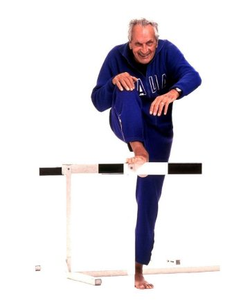 MILAN, ITALY - NOVEMBER 01:  Italian fashion designer Ottavio Missoni poses dressed as he performed the final of the 400m hurdle race at the 1948 Olympics in London at a photo shoot held on November 1, 1999 in Milan, Italy. The stylist was also Italian champion for the 400m hurdles in 1947. Ottavio Missoni will celebrate his ninetieth birthday on February 11, 2011. (Photo by Franco Origlia/Getty Images)