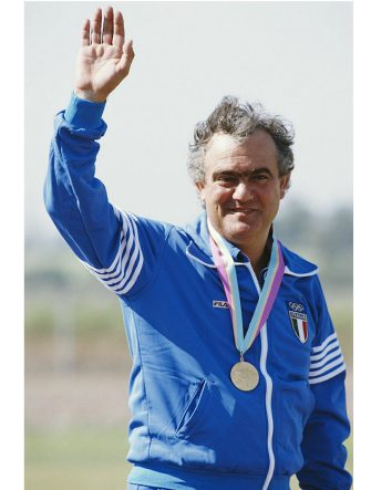 Luciano Giovannetti of Italy celebrates winning the gold medal in the Mixed Trap shooting event on 31st July 1984 during the XXIII Olympic Summer Games at the Prado Recreational Area, Chino, California, United States. (Photo by Getty Images)