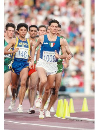 BARCELONA, SPAIN - AUGUST 5:  Alessandro Lambruschini #1009 of Italy runs in semi final of the Men's 3000 meters steeplechase race of the Athletics competition of the 1992 Summer Olympics on August 5, 1992 at the Montjuic Olympic Stadium in Barcelona, Spain.  (Photograph by David Madison/Getty Images)
