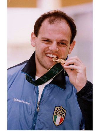 20 Jul 1996:  Roberto Di Donna of Italy biting  his medal after winning gold in the Mens 10m Air Pistol event at the Wolf Creek Shooting Complex during the Centennial Olympic Games in Atlanta, Georgia, USA Mandatory Credit: Rusty Jarrett  /Allsport