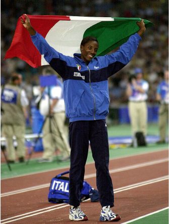 29 Sep 2000: Fiona May of Italy celebrates winning the silver medal in the womens long jump final during the Sydney 2000 Olympic Games at Olympic Stadium, Sydney Olympic Park, Sydney, Australia.  DIGITAL IMAGE Mandatory Credit: Darren England/ALLSPORT