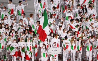 TOKYO, JAPAN  JULY 23, 2021: Delegation from Italy takes part in the Parade of Nations at the opening ceremony of the Tokyo 2020 Summer Olympic Games at the National Stadium. Tokyo was to host the 2020 Summer Olympics from 24 July to 9 August 2020, however because of the COVID-19 pandemic the games have been postponed for a year and are due to take place from 23 July to 8 August 2021. Stanislav Krasilnikov/TASS (Photo by Stanislav Krasilnikov\TASS via Getty Images)