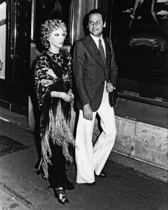 Pugliese broadcast presenter Renzo Arbore and his partner, Milanese-born theatrical actress Mariangela Melato walking along the street, out of the renowned Bagaglino Theatre, where runs the show La Grande Eugène, a cabaret show starring transvestite. Rome (Italy), 1974. (Photo by Mondadori via Getty Images)