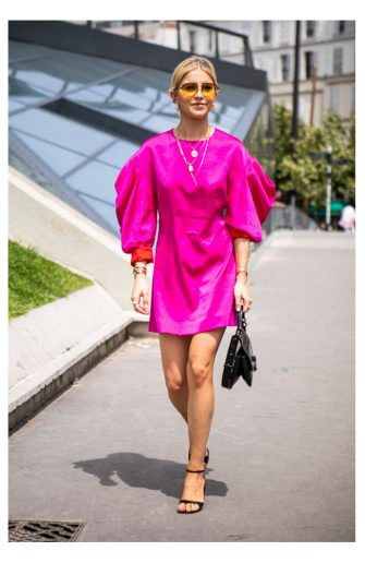 PARIS, FRANCE - JUNE 23: Caroline Daur, wearing a hot pink dress, black sandals and black Kenzo bag, is seen outside Kenzo fashion show on Day 6 during the Paris Fashion Week Spring/Summer 202> on June 23, 2019 in Paris, France. (Photo by Claudio Lavenia/Getty Images)