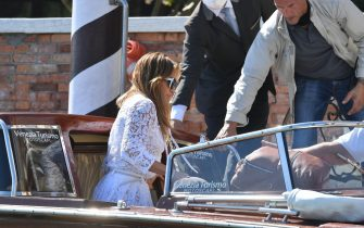 US actress and singer Jennifer Lopez arrives at the Cipriani hotel aboard a vaporetto taxi boat on September 9, 2021 after she arrived along with US actor Ben Affleck (inside boat) to attend the 78th Venice Film Festival in Venice. (Photo by Filippo MONTEFORTE / AFP) (Photo by FILIPPO MONTEFORTE/AFP via Getty Images)