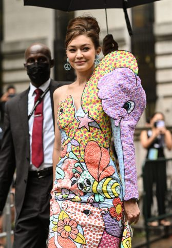NEW YORK, NEW YORK - SEPTEMBER 09: Gigi Hadid is seen wearing a Moschino dress outside the Moschino show during New York Fashion Week S/S 22 on September 09, 2021 in New York City. (Photo by Daniel Zuchnik/Getty Images)