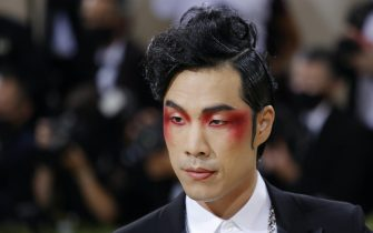epa09466934 Eugene Lee Yang poses on the red carpet for the 2021 Met Gala, the annual benefit for the Metropolitan Museum of Art's Costume Institute, in New York, New York, USA, 13 September 2021. The event coincides with the Met Costume Institute's first two-part exhibition, 'In America: A Lexicon of Fashion' which opens 18 September 2021, to be followed by 'In America: An Anthology of Fashion' which opens 05 May 2022 and both conclude 05 September 2022.  EPA/JUSTIN LANE