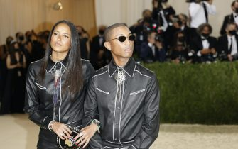 epa09466919 Pharrell Williams (R) and Helen Lasichanh poses on the red carpet for the 2021 Met Gala, the annual benefit for the Metropolitan Museum of Art's Costume Institute, in New York, New York, USA, 13 September 2021. The event coincides with the Met Costume Institute's first two-part exhibition, 'In America: A Lexicon of Fashion' which opens 18 September 2021, to be followed by 'In America: An Anthology of Fashion' which opens 05 May 2022 and both conclude 05 September 2022.  EPA/JUSTIN LANE