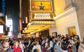 NEW YORK, NEW YORK - SEPTEMBER 14: Patrons fill the street after Hamilton at The Richard Rodgers Theatre on reopening night  on September 14, 2021 in New York City. Four major musicals including Wicked, Chicago, Hamilton and The Lion King all reopened tonight for the first time since Broadway shut down 18 months ago due to the coronavirus pandemic. All broadway shows are requiring patrons be vaccinated and masked except when eating or drinking.  (Photo by Alexi Rosenfeld/Getty Images)