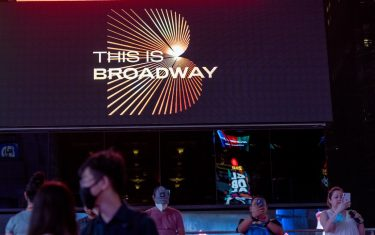 """NEW YORK, NEW YORK - SEPTEMBER 14: View of a """"This Is Broadway"""" sign on September 14, 2021 in New York City. Four major musicals including """"Wicked"""", """"Chicago"""", """"Hamilton"""" and """"The Lion King"""" all reopened tonight for the first time since Broadway shut down 18 months ago due to the coronavirus pandemic. All Broadway shows are requiring patrons be vaccinated and masked except when eating or drinking.  (Photo by Alexi Rosenfeld/Getty Images)"""