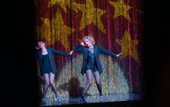 """NEW YORK, NEW YORK - SEPTEMBER 14: (L-R) Bianca Marroquín and Ana Villafañe perform on stage during """"Chicago"""" at Ambassador Theatre on reopening night on September 14, 2021 in New York City. """"Chicago"""" along with three other major musicals reopened tonight after being closed for 18 months due to the coronavirus pandemic. All Broadway shows are requiring patrons be vaccinated and masked except when eating or drinking. (Photo by Alexi Rosenfeld/Getty Images)"""