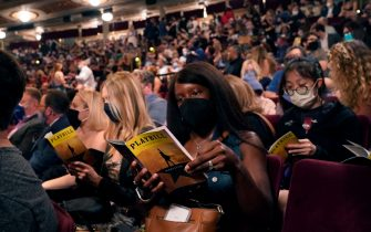 """People wait in the audience at the Broadway musical """"Hamilton"""" on September 14, 2021 in New York, as the highest grossing Broadway musical of all time returns after 18 months in the dark due the coronavirus pandemic. - Lion King, Wicked and Chicago also opened for the fully vaccinated. (Photo by TIMOTHY A. CLARY / AFP) (Photo by TIMOTHY A. CLARY/AFP via Getty Images)"""