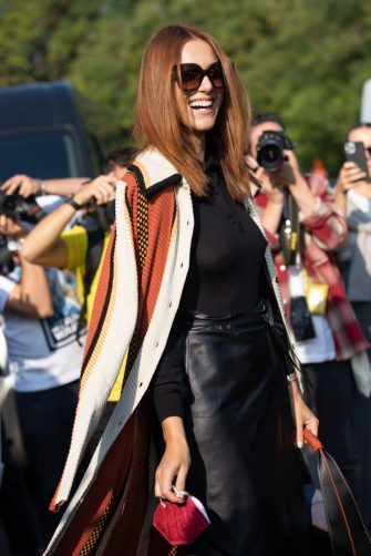MILAN, ITALY - SEPTEMBER 24: Actress Miriam Leone outside Tod's fashion show wearing a Long striped coat, black leather skirt and black top and bag during the Milan Fashion Week - Spring / Summer 2022 on September 24, 2021 in Milan, Italy. (Photo by Valentina Frugiuele/Getty Images)