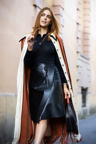 MILAN, ITALY - SEPTEMBER 24: Actress Miriam Leone, wearing a long striped coat, black leather skirt, black top and bag, poses ahead of the Tods fashion show during the Milan Fashion Week - Spring / Summer 2022 on September 24, 2021 in Milan, Italy. (Photo by Claudio Lavenia/Getty Images)