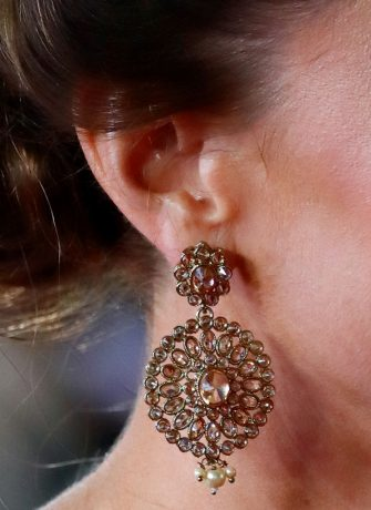"""LONDON, UNITED KINGDOM - SEPTEMBER 28: (EMBARGOED FOR PUBLICATION IN UK NEWSPAPERS UNTIL 24 HOURS AFTER CREATE DATE AND TIME) Catherine, Duchess of Cambridge (earring detail) attends the """"No Time To Die"""" World Premiere at the Royal Albert Hall on September 28, 2021 in London, England. (Photo by Max Mumby/Indigo/Getty Images)"""