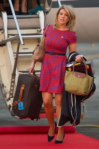 ASSAM, INDIA - APRIL 12: The Duchess of Cambridge's PA and Stylist Natasha Archer carries items of luggage as she arrives at Tezpur Airport on April 12, 2016 in Assam, India. The Duke and Duchess of Cambridge are on a week-long tour of India and Bhutan taking in Mumbai, Delhi, Assam, Bhutan and Agra. (Photo by Dominic Lipinski - Pool/Getty Images)