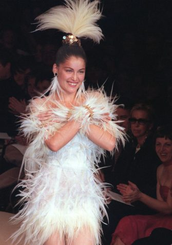 Model Laetitia Casta presents the wedding dress for Yves Saint-Laurent Haute Couture Spring-Summer 2000 collection, 19 January 2000 in Paris. (Photo by JEAN-PIERRE MULLER / AFP) (Photo by JEAN-PIERRE MULLER/AFP via Getty Images)
