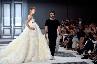 PARIS, FRANCE - JULY 06:  A model pose with designer Giambattista Valli on the runway following the Giambattista Valli show as part of Paris Fashion Week Haute Couture Fall/Winter 2015/2016 on July 6, 2015 in Paris, France.  (Photo by Pascal Le Segretain/Getty Images)