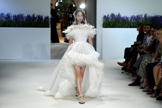 A model presents a creation by Giambattista Valli during the 2018-2019 Fall/Winter Haute Couture collection fashion show in Paris, on July 2, 2018. (Photo by Bertrand GUAY / AFP)        (Photo credit should read BERTRAND GUAY/AFP via Getty Images)