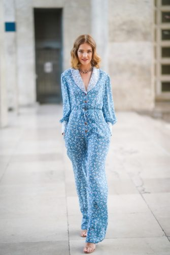 PARIS, FRANCE - JULY 01: Natalia Vodianova wears a blue floral print jacket, a necklace, flare pants, outside the Ulyana Sergeenko show, during Paris Fashion Week -Haute Couture Fall/Winter 2019/2020, on July 01, 2019 in Paris, France. (Photo by Edward Berthelot/Getty Images)