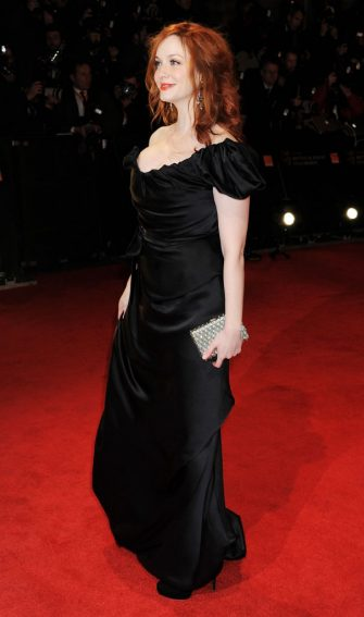 LONDON, ENGLAND - FEBRUARY 12:  (EMBARGOED FOR PUBLICATION IN UK TABLOID NEWSPAPERS UNTIL 48 HOURS AFTER CREATE DATE AND TIME. MANDATORY CREDIT PHOTO BY DAVE M. BENETT/GETTY IMAGES REQUIRED)  Actress Christina Hendricks arrives at the Orange British Academy Film Awards 2012 at The Royal Opera House on February 12, 2012 in London, England.  (Photo by Dave M. Benett/Getty Images)