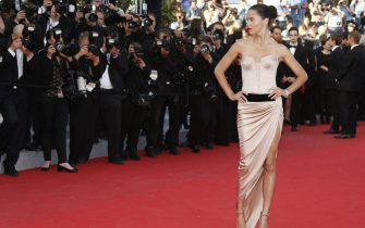 epa04213152 Brazilian model Adriana Lima arrives for the screening of 'The Homesman' during the 67th annual Cannes Film Festival, in Cannes, France, 18 May 2014. The movie is presented in the Official Competition of the festival which runs from 14 to 25 May.  EPA/GUILLAUME HORCAJUELO