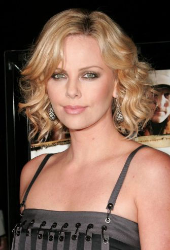 """HOLLYWOOD - MARCH 06:  Actress/producer Charlize Theron arrives at Overture Films' screening of """"Sleepwalking"""" held at the Director's Guild of America on March 6, 2008 in Hollywood, California.  (Photo by David Livingston/Getty Images for Overture)"""