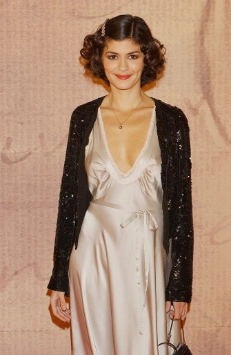 """MADRID, SPAIN - JANUARY 24:  Actress Audrey Tautou attends the premiere of her new movie """"A Very Long Engagement"""" (""""Un Long Dimanche de Fiancailles"""") at Palacio de la Musica Cinema on January 24, 2005 in Madrid, Spain.  (Photo by Carlos Alvarez/Getty Images)"""