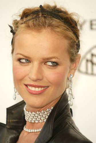 """CANNES, FRANCE - MAY 20:   Model Eva Herzigova, wearing Chopard, arrives at """"Cinema Against AIDS 2004"""", the 11th annual event in aid of amfAR (American Foundation for AIDS Research) at Le Moulin de Mougins at the 57th Cannes Film Festival on May 20, 2004 in Cannes, France. (Photo by Evan Agostini/Getty Images)"""