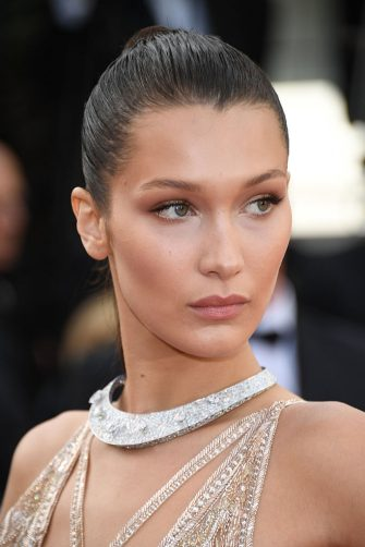 CANNES, FRANCE - MAY 11:  Bella Hadid attends the 'Cafe Society' premiere and the Opening Night Gala during the 69th annual Cannes Film Festival at the Palais des Festivals on May 11, 2016 in Cannes, .  (Photo by Venturelli/WireImage)