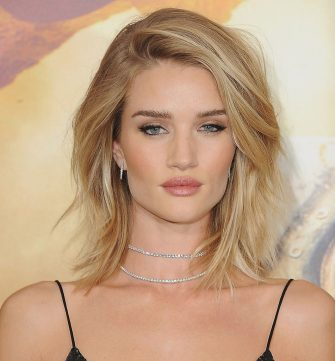 """HOLLYWOOD, CA - MAY 07:  Actress Rosie Huntington-Whiteley arrives at the Los Angeles Premiere """"Mad Max: Fury Road"""" at TCL Chinese Theatre IMAX on May 7, 2015 in Hollywood, California.  (Photo by Jon Kopaloff/FilmMagic)"""
