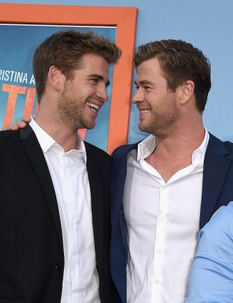"WESTWOOD, CA - JULY 27:  Actors Liam Hemsworth and Chris Hemsworth attend the premiere of Warner Bros. Pictures ""Vacation"" at Regency Village Theatre on July 27, 2015 in Westwood, California.  (Photo by Kevin Winter/Getty Images)"