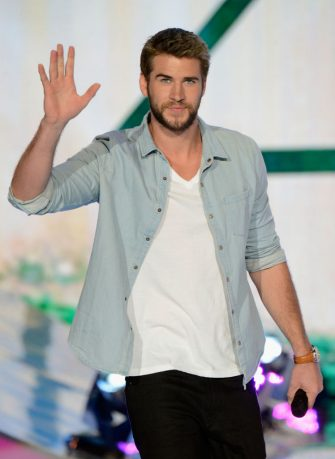 UNIVERSAL CITY, CA - AUGUST 11:  Actor Liam Hemsworth appears onstage at the 2013 Teen Choice Awards at Gibson Amphitheatre on August 11, 2013 in Universal City, California.  (Photo by Kevin Mazur/Fox/WireImage)