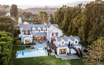 BGUK_2064568 - Los Angeles, CA  - Coldplay's Chris Martin and girlfriend Dakota Johnson reportedly buy $12.5 million Malibu, CA love nest together. The couple, who have been together for three years since October 2017, snapped up a white modern Cape Cod style estate complete with a swimming pool, hot tub and home theater for $12.5million in October 2020, according to a report in the New York Post. The swanky Malibu home was first placed on the market in July 2020 for $14million.  There are a total of six bedrooms and nine bathrooms in the home that is 5,338 sq ft over two levels.  There is also a two-story guest house with a game room, living room, kitchen and bedroom for any guests of the couple. The outdoor area is large and plush with a long swimming pool, attached hot tub, a lounge area as well as a dining area with fireplace, and a full outdoor barbecue section that includes a bar. The property is gated and has plenty of security for the Brit singer and the  50 Shades of Grey actress as mature trees also line the property for added privacy. The living room has a fireplace and stunning views of the Pacific Ocean and the surrounding mountains while the kitchen is huge with a marble top island. The master bathroom offers two counters and a stand-alone white tub in front of a window.