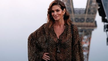 US model Cindy Crawford poses for photographs upon her arrival prior to the Yves Saint Laurent Spring-Summer 2019 Ready-to-Wear collection fashion show in Paris, on September 25, 2018. (Photo by FRANCOIS GUILLOT / AFP)        (Photo credit should read FRANCOIS GUILLOT/AFP via Getty Images)