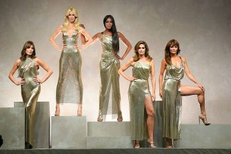 MILAN, ITALY - SEPTEMBER 22:  Carla Bruni, Claudia Schiffer, Naomi Campbell, Cindy Crawford and Helena Christensen walk the runway at the Versace show during Milan Fashion Week Spring/Summer 2018 on September 22, 2017 in Milan, Italy.  (Photo by Venturelli/WireImage,)