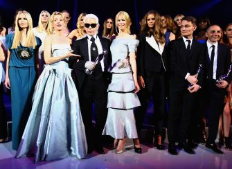 BERLIN - JULY 19:  Karl Lagerfeld stands with Claudia Schiffer (4th-R), Maria Furtwaengler (2nd-L) and Natasha Poly (L) at the ELLE Fashion Star award ceremony during Mercedes Benz Fashion week Spring/Summer 2009 at the Tempodrom on July 19, 2008 in Berlin, Germany. Lagerfeld received the ELLE Fashion Star 'Platinium' award for lifetime achievement.  (Photo by Andreas Rentz/Getty Images)