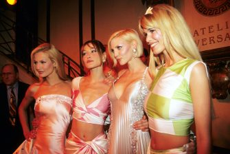 PARIS, FRANCE - JANUARY 01: Karen Mulder, Carla Bruni, Nadja Auermann and Claudia Schiffer attend the Versace High Fashion Show at the Ritz Hotel on January 1,1995 in Paris, France.  (Photo by Foc Kan/WireImage)