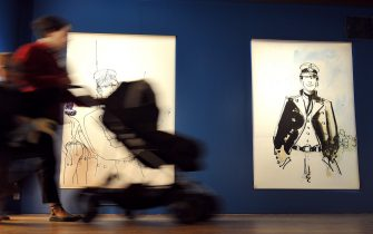 "A person walks past drawings of Italian cartoonist and script-writer Hugo Pratt on April 8, 2009 during a visit of the exhibition ""Secret journeys"" dedicated to his work at the Thomas-Henry art museum in Cherbourg, northern France. The exhibition takes place until September 20, 2009 showing major works, prints, graphic analyses, panoramas, sketches and silkscreen prints... Pratt, author of the famed Corto Maltese comic book series, died in 1995.  AFP  PHOTO   MYCHELE DANIAU        (Photo credit should read MYCHELE DANIAU/AFP via Getty Images)"