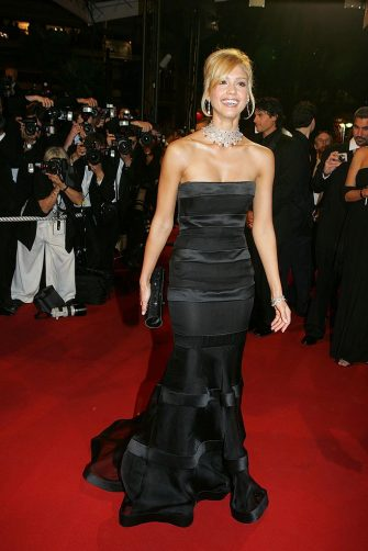 """FRANCE - MAY 18:  58th Cannes Film Festival: Stairs of """"Sin City"""" in Cannes, France On May 18, 2005-Jessica Alba dressed by Giorgio Armani Prive, jewelry Chopard.  (Photo by Pool BENAINOUS/CATARINA/LEGRAND/Gamma-Rapho via Getty Images)"""