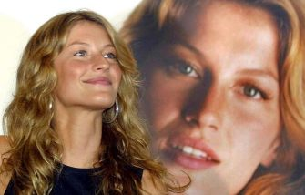 Top Brazilian model Gisele Bundchen poses next to a photo of herself during a press conference in Sao Paulo, Brazil 14 February 2001 during a presentation of a campaign for a new store.   AFP PHOTO / Mauricio LIMA (Photo by MAURICIO LIMA / AFP) (Photo by MAURICIO LIMA/AFP via Getty Images)