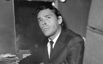PARIS, FRANCE:  A photo taken 07 October 1966 shows Belgian singer Jacques Brel in his dressing room during his last show at Olympia music-hall in Paris. Jacques Brel died from a cancer 25 years ago, 09 October 1978. (Photo credit should read AFP/AFP via Getty Images)
