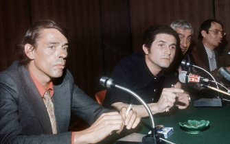 "CANNES, FRANCE:  Photo taken in May 1972 in Cannes of Belgian born singer and actor Jacques Brel (L) and film director Claude Lelouch (2dL), during a press conference to present their film ""L'aventure c'est l'aventure"" for the Cinema Festival. Brel was born 08 April 1929 in Schaerbeek, near Brussels. Brel, most famous for his intense redition of his own love song ""Ne me quitte pas"" (Don't leave me), died 09 October 1978. AFP PHOTO (Photo credit should read AFP/AFP via Getty Images)"