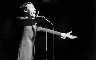 (FILES) - This file photo dated 07 October 1966 shows Belgian singer Jacques Brel singing for during his last show at Olympia music-hall in Paris. Jacques Brel died from a cancer 25 years ago, 09 October 1978 .    AFP PHOTO  (Photo credit should read -/AFP via Getty Images)