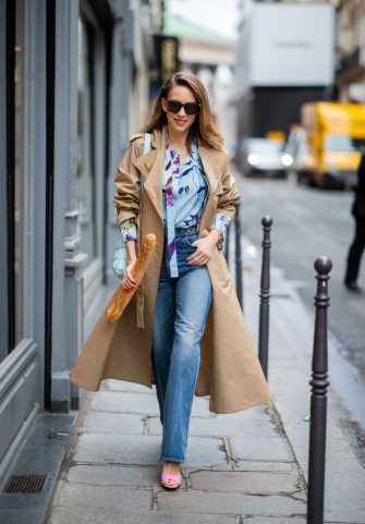 PARIS, FRANCE - FEBRUARY 25: Alexandra Lapp is seen walking around Paris with French Baguette wearing Jeans Jane Flare from Celine, double breasted trench coat from Valentino, Stella McCartney blouse, Bottega Veneta Padded Cassette leather bag in light blue, Gucci mules in pink, Bottega Veneta sunglasses - all from Breuninger during Paris Fashion Week - Womenswear Fall/Winter 2020/2021 : Day Two on February 25, 2020 in Paris, France. (Photo by Christian Vierig/Getty Images)