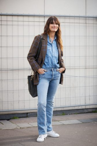 PARIS, FRANCE - FEBRUARY 26: Caroline de Maigret wearing plaid blazer, denim shirt and jeans outside the Dries van Noten show during the Paris Fashion Week Womenswear Fall/Winter 2020/2021 on February 26, 2020 in Paris, France. (Photo by Hanna Lassen/Getty Images)