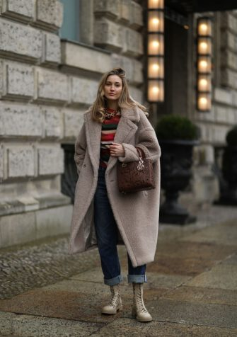 BERLIN, GERMANY - FEBRUARY 04: Mandy Bork wearing boots, sweater and bag Dior, Max Mara Teddy coat and Citizen of Humanity blue jeans on February 04, 2021 in Berlin, Germany. (Photo by Jeremy Moeller/Getty Images)